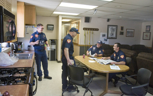 Paul Fraughton   |  The  Salt Lake Tribune Firefighters at Taylorsville's Station No. 117 gather in the kitchen/living room of their cramped station. From left Chris Nelson, Adam Halsey, Capt. Jeff Taylor and Eric Benson.                             Monday, September 9, 2013
