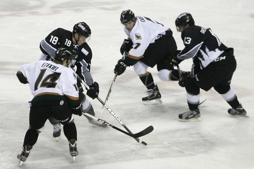Chris Detrick  |  The Salt Lake Tribune Grizzlies' Norm Ezekiel (14) Grizzlies' Brance Orban (7) Steelheads' Gaelan Patterson (18) and Steelheads' David de Kastrozza (13) go for the puck during the game at Maverik Center Friday October 18, 2013.