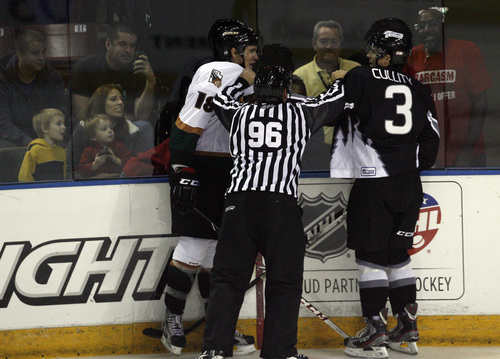 Chris Detrick  |  The Salt Lake Tribune Linesmen James McKenna breaks up Grizzlies' Teigan Zahn (18) and Steelheads' Patrick Cullity (3) during the game at Maverik Center Friday October 18, 2013.