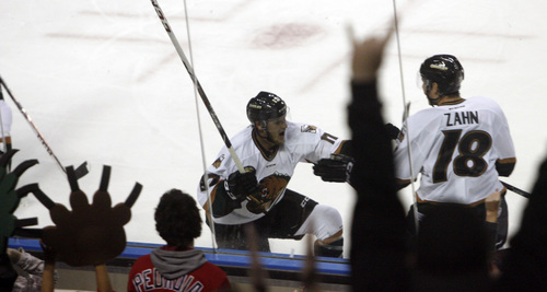 Chris Detrick  |  The Salt Lake Tribune Grizzlies' Jamie MacQueen (17) celebrates his second goal with Grizzlies' Teigan Zahn (18) during the game at Maverik Center Friday October 18, 2013. The Grizzlies are winning 2-0.