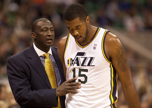 Lennie Mahler  |  The Salt Lake Tribune Jazz coach Tyrone Corbin speaks with Derrick Favors as the Jazz face the Portland Trailblazers at EnergySolutions Arena on Wednesday, Oct. 16, 2013.