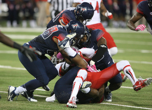 Steve Griffin     The Salt Lake Tribune  Utah Utes wide receiver Dres Anderson (6) gets gang tackled by the Arizona defense during first half action in the University of Utah versus University of Arizona football game at Arizona Stadium in Tucson, Ariz., Saturday, October 19, 2013.