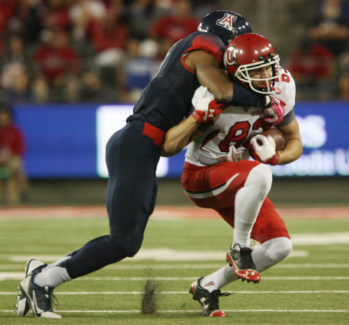 Steve Griffin     The Salt Lake Tribune  Utah Utes wide receiver Sean Fitzgerald (83) gets tackled by Arizona Wildcats cornerback Shaquille Richardson (5)during first half action in the University of Utah versus University of Arizona football game at Arizona Stadium in Tucson, Ariz., Saturday, October 19, 2013.