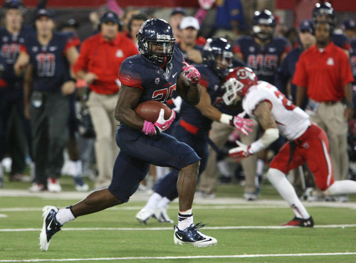 Steve Griffin     The Salt Lake Tribune  Arizona Wildcats running back Ka'Deem Carey (25) breaks the game open as he races to a touchdown during second half action in the University of Utah versus University of Arizona football game at Arizona Stadium in Tucson, Ariz., Saturday, October 19, 2013.