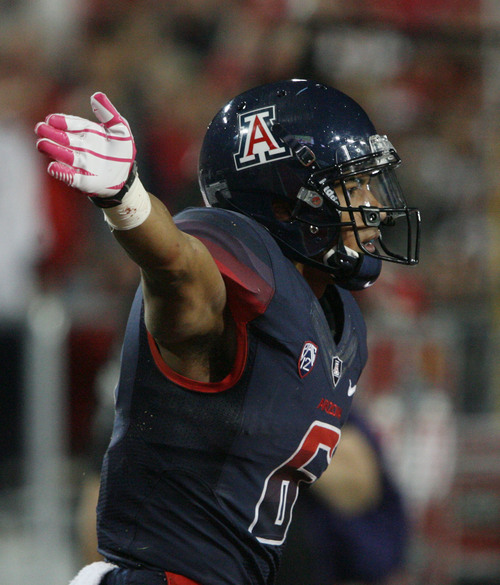 Steve Griffin     The Salt Lake Tribune  Arizona Wildcats wide receiver Nate Phillips (6) signals a first down after catching a long pass during second half action in the University of Utah versus University of Arizona football game at Arizona Stadium in Tucson, Ariz. Saturday, October 19, 2013.