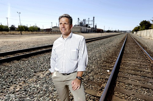 In this photo taken Monday, July 15, 2013, Jeff Morales, chief executive officer of the California High Speed Rail Authority, poses in Fresno, Calif. where construction of the controversial $68 billion bullet train is set to begin. California voters approved a plan to build a high-speed rail system to link Northern and Southern California five years ago.    Voters were promised that the rail line would improve access to good-paying jobs, cut pollution and reduce traffic congestion. With work about to begin on the first 30-mile segment in the Central Valley, the region that could see the most benefits is also where opposition has grown most fierce.(AP Photo/Rich Pedroncelli)