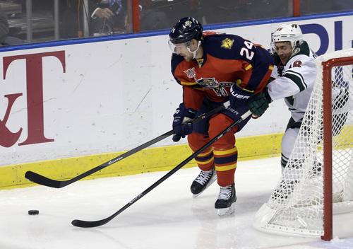 Minnesota Wild defenseman Jared Spurgeon (46) checks Florida Panthers center Brad Boyes (24) in the third period of an NHL hockey game, Saturday, Oct. 19, 2013, in Sunrise, Fla. ((AP Photo/Alan Diaz)