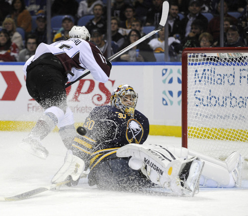 Colorado Avalanche PA Parenteau (15) is stopped by Buffalo Sabres goaltender Ryan Miller (30) during the second period of an NHL hockey game in Buffalo, N.Y., Saturday, Oct. 19, 2013. (AP Photo/Gary Wiepert)