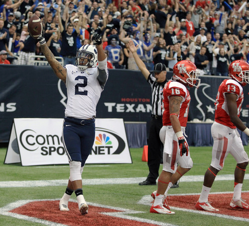 BYU's Cody Hoffman (2) celebrates his touchdown during the second half of an NCAA college football game, Saturday, Oct. 19, 2013 in Houston. (AP Photo/Eric Christian Smith)