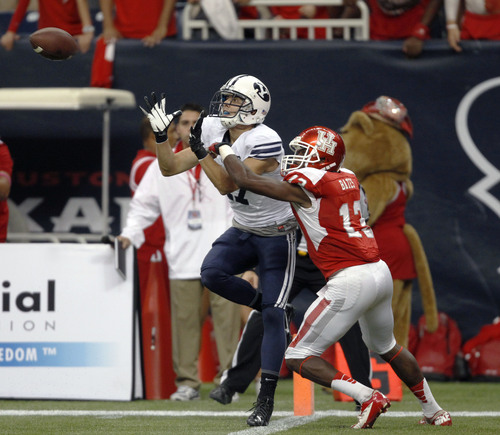 BYU's Skyler Ridley, left, catches the game-winning touchdown as Houston's Thomas Bates defends during the second half of an NCAA college football game, Saturday, Oct. 19, 2013 in Houston. BYU defeated Houston, 47-46. (AP Photo/Eric Christian Smith)