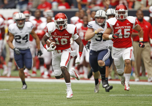 Houston's Zach McMillian (10) runs back a kickoff ninety-five yards for a touchdown during the first half of an NCAA college football game against BYU, Saturday, Oct. 19, 2013 in Houston. (AP Photo/Eric Christian Smith)