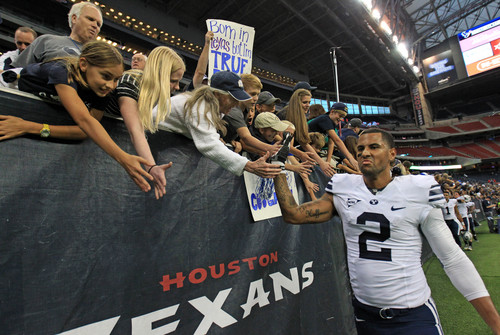 BYU's Cody Hoffman (2) celebrates with fans the Cougars' 47-46 victory over Houston in an NCAA college football game, Saturday, Oct. 19, 2013 in Houston.(AP Photo/Eric Christian Smith)