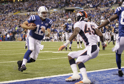 Indianapolis Colts quarterback Andrew Luck (12) runs into the end zone for a touchdown during the second half of an NFL football game against the Denver Broncos, Sunday, Oct. 20, 2013, in Indianapolis. (AP Photo/AJ Mast)