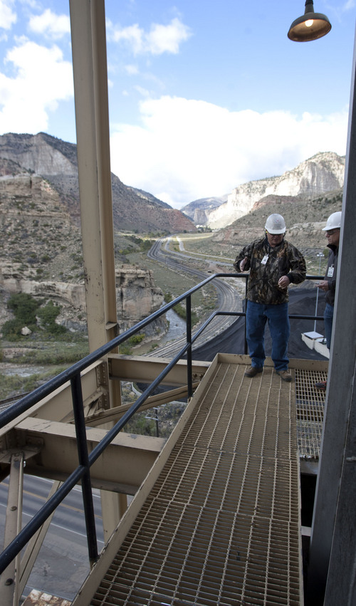 Steve Griffin  |  The Salt Lake Tribune  Standing on a cat walk at the top of the Carbon Power Plant, power plant manager Kyle Davis, talks about the  a 60-year-old coal-fired electical-generating station, near Helper, Utah Friday, September 27, 2013. The plant faces an early retirement in the face of EPA's new emission standards for mercury and other toxic pollutants. The new rules require old plants to install pollution-control equipment, but the Carbon plant's setting in a narrow canyon make that impossible.