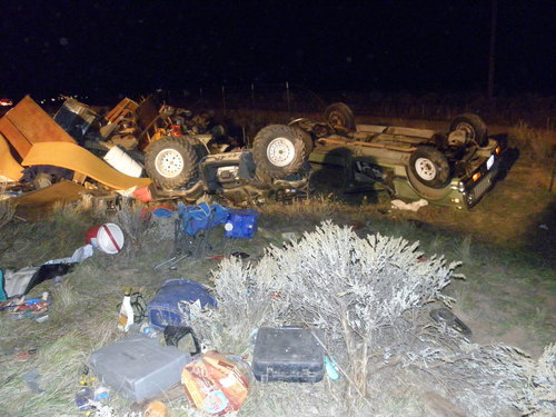  Utah Highway Patrol photo  A woman was killed and two people injured when their vehicle, which was towing two trailers, crashed on I-15 about 8 miles south of Cedar City on Sunday night.