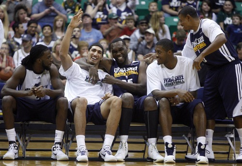 Kim Raff | The Salt Lake Tribune Jazz players (middle left) Enes Kanter and Al Jefferson wave to the crowd during introductions a the Jazz Scrimmage at EnergySolutions Arena in Salt Lake City, Utah on October 6, 2012.