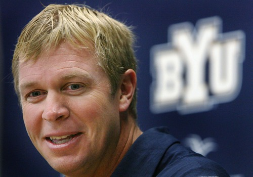 BYU football coach Bronco Mendenhall signed an extension June 26, 2013, through 2016.