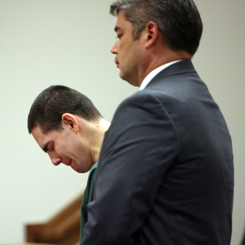 Steve Griffin  |  The Salt Lake Tribune  Standing with his attorney Dusty Kawai, Joshua Petersen, left, weeps and lowers his head after receiving a sentence of life in prison without the chance of parole in Judge Darold McDade's courtroom in the Fourth District Court in Provo, Utah Monday, October 21, 2013. Petersen plead guilty, last month, to aggravated murder for the April 5 shooting death of his 5-month-old son, Ryker Petersen.