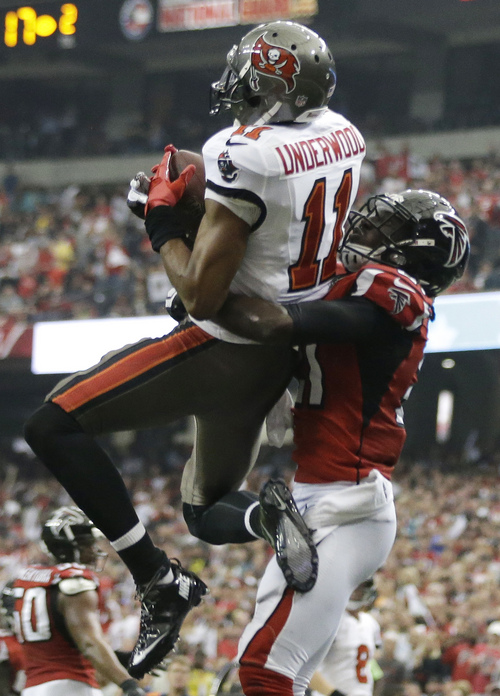 Tampa Bay Buccaneers wide receiver Tiquan Underwood (11) makes a catch in the end zone against Atlanta Falcons cornerback Desmond Trufant (21) during the second half of an NFL football game, Sunday, Oct. 20, 2013, in Atlanta. The touchdown was nullified after a penalty. (AP Photo/David Goldman)