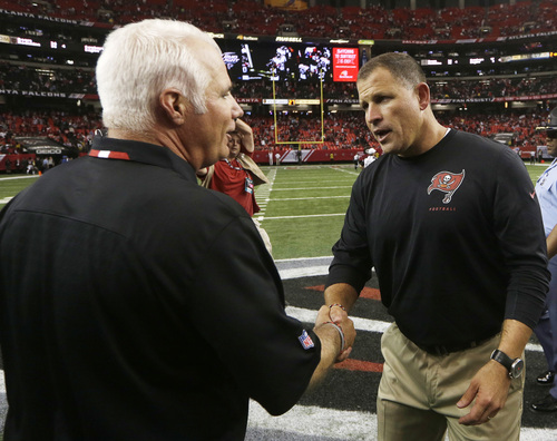 Atlanta Falcons head coach Mike Smith, lefts greets Tampa Bay Buccaneers head coach Greg Schiano at mid field after the second half of an NFL football game, Sunday, Oct. 20, 2013, in Atlanta. The Atlanta Falcons won 31-23. (AP Photo/John Bazemore)