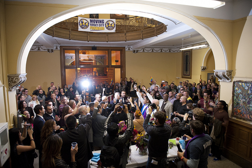 Gay couples and their guests take part in a toast in the rotunda of City Hall after the ceremony. David Gibson and Richard Kiamco of Jersey City make history as they become the first official same-sex couple to be married in Jersey City in a ceremony officiated by Mayor Steve Fulop at 12:01 a.m. Monday, Oct. 21, 2013, at City Hall. Seven other gay couples also participated in the ceremony. (AP Photo/The Jersey Journal, Reena Rose Sibayan)