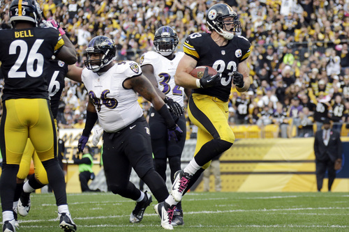 Pittsburgh Steelers tight end Heath Miller, right, gets into the end zone past Baltimore Ravens defensive end Marcus Spears (96) for a touchdown in the first quarter of an NFL football game in Pittsburgh on Sunday, Oct 20, 2013. (AP Photo/Gene J. Puskar)