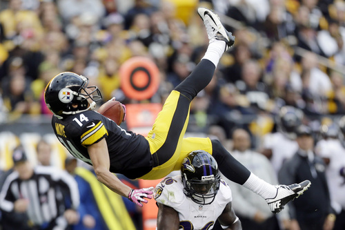 Pittsburgh Steelers wide receiver Derek Moye (14) flips over Baltimore Ravens free safety Matt Elam after making a catch in the second quarter of an NFL football game in Pittsburgh on Sunday, Oct 20, 2013. (AP Photo/Gene J. Puskar)