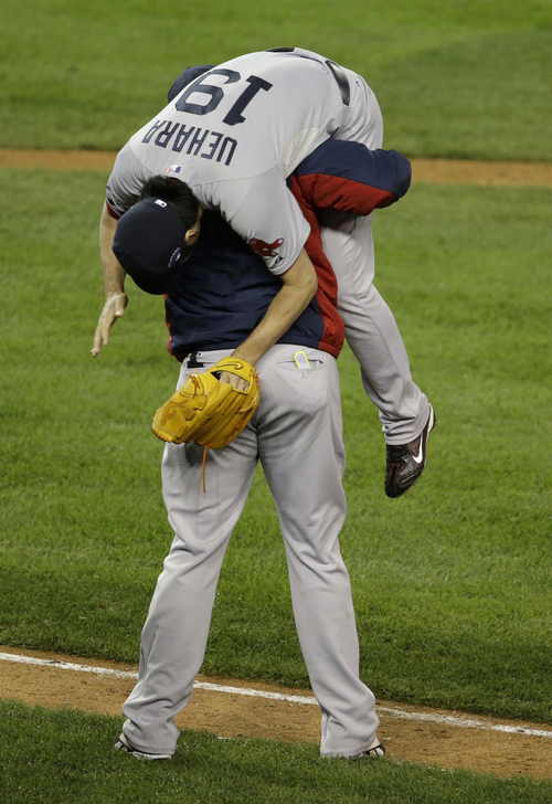 Boston Red Sox's David Ortiz picks up Koji Uehara after the Red Sox defeating the Detroit Tigers 4-3 in Game 5 of the American League baseball championship series Thursday, Oct. 17, 2013, in Detroit. (AP Photo/Carlos Osorio)