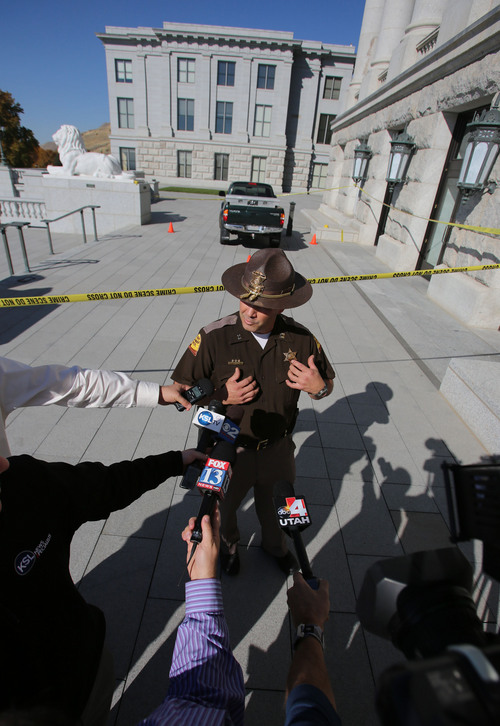 Francisco Kjolseth  |  The Salt Lake Tribune UHP Captain Barton Blair discusses an incident where a man reportedly was shocked with a stun gun after driving a truck up several flights of stairs to the West entrance to the Utah State Capitol on Tuesday, Oct. 22. The driver is in custody as UHP investigates the incident.