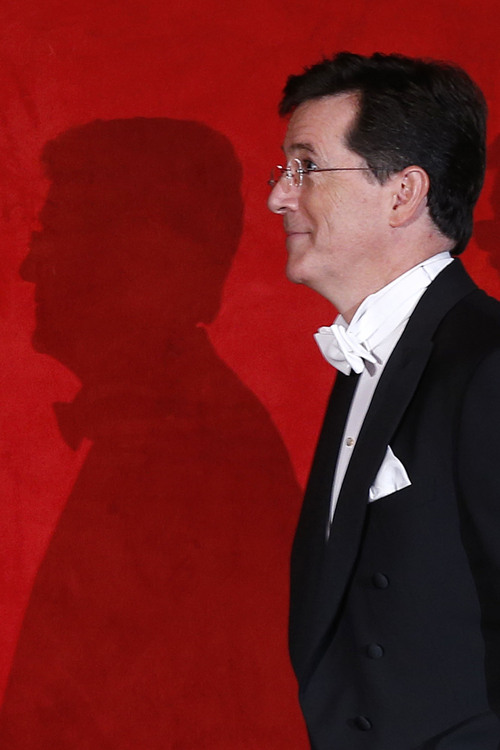 Stephen Colbert is introduced as he takes the dais during the Alfred E. Smith Memorial Foundation Dinner, a charity gala organized by the Archdiocese of New York, at the Waldorf-Astoria hotel, Thursday, Oct. 17, 2013, in New York. (AP Photo/Jason DeCrow)