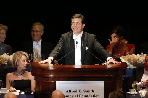 Stephen Colbert delivers the keynote address during the Alfred E. Smith Memorial Foundation Dinner, a charity gala organized by the Archdiocese of New York, at the Waldorf-Astoria hotel, Thursday, Oct. 17, 2013, in New York. (AP Photo/Jason DeCrow)