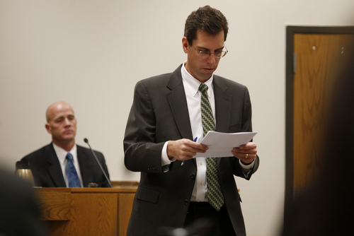 Mark Johnston  |  Pool  Defense attorney Randy Spencer reviews material during the trial of Martin MacNeill at the 4th District Court in Provo Tuesday, Oct. 22, 2013. MacNeill is charged with murder for allegedly killing his wife Michele MacNeill in 2007.