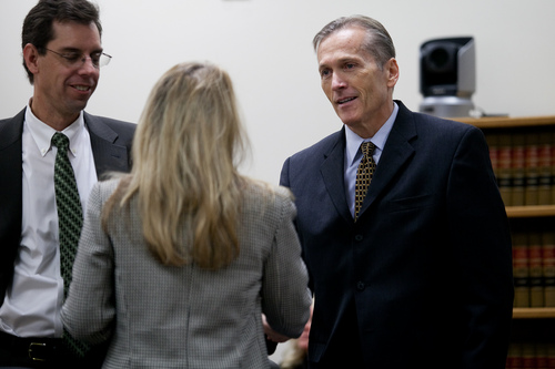 Mark Johnston  |  Pool  Pleasant Grove physician Martin MacNeill, right, charged with murder for allegedly killing his wife Michele MacNeill in 2007, greets his attorneys in Judge Derek Pullan's 4th District Court in Provo Tuesday, Oct. 22, 2013.