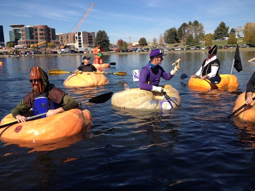 Keith Johnson   |   The Salt Lake Tribune Racers prepare to paddle their hollowed-out giant pumpkins at the Pumpkin Regatta at Sugar House Park, Oct. 19, 2013 in Salt Lake City.