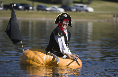 Keith Johnson   |   The Salt Lake Tribune Pirate David Bradley waits in his hollowed-out pumpkin for the first heat of the Pumpkin Regatta at Sugar House Park in Salt Lake City on Saturday. Participants raced pumpkins weighing between 500 and 1,000 pounds.