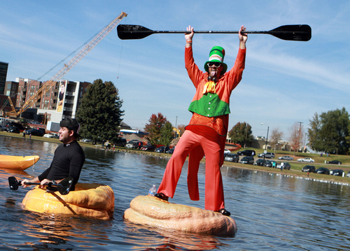 Keith Johnson  |  The Salt Lake Tribune Kyle Fox celebrates after winning the championship heat during the Pumpkin Regatta at Sugar House Park in Salt Lake City, October 19, 2013. Participants raced pumpkins weighing between 500 and 1,000 pounds.
