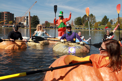 Keith Johnson  |  The Salt Lake Tribune Costumed pumpkin paddlers acknowledge the crowd assembled on the bank of the pond at Sugar House Park following the Pumpkin Regatta in Salt Lake City, October 19, 2013. Participants raced pumpkins weighing between 500 and 1,000 pounds.
