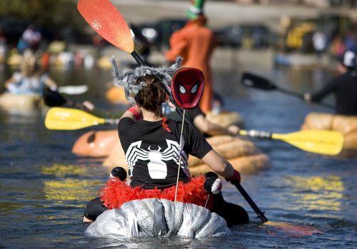 Keith Johnson  |  The Salt Lake Tribune Aubrey Kruisman dressed as Spider woman paddles her giant pumpkins in the pond at Sugar House park during the Pumpkin Regatta in Salt Lake City on Saturday. Participants raced pumpkins weighing between 500 and 1,000 pounds.