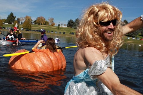 Keith Johnson  |  The Salt Lake Tribune Robb Baumann wears a cinderella costume while participating in the Pumpkin Regatta at Sugar House Park in Salt Lake City, October 19, 2013. Participants raced pumpkins weighing between 500 and 1,000 pounds.