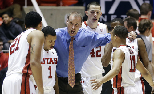 Utah head coach Larry Krystkowiak huddles with his team in the second half of an NCAA college basketball game against Arizona State, Wednesday, Feb. 13, 2013, in Salt Lake City. Utah won 60-55. (AP Photo/Rick Bowmer)