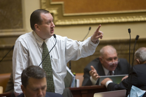 Al Hartmann  |  Tribune file photo State Auditor-elect John Dougall says he will retain most of the employees in the office, although it is one of the few agencies where he has the power to hire and fire all staffers at will. In this file photo, the state Republican lawmaker from Highland, speaks on the House floor.