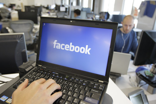 FILE - This Feb. 8, 2012, file photo, shows a view inside Facebook headquarters in Menlo Park, Calif. Facebook announced Tuesday, Oct. 22, 2013, it was working on new ways to keep users from stumbling across gruesome content on its website following an outcry over the discovery of beheading videos there. (AP Photo/Paul Sakuma, File)