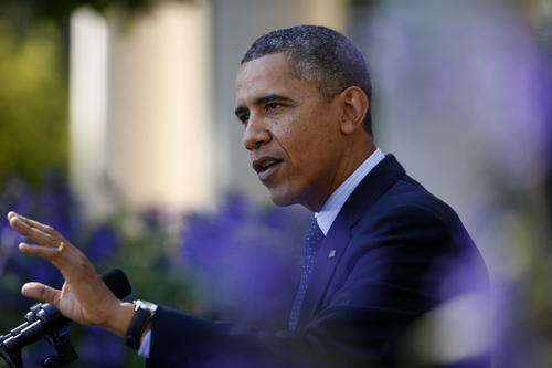 President Barack Obama gestures while speaking in the Rose Garden of the White House in Washington, Monday, Oct. 21, 2013, on the initial rollout of the health care overhaul. Obama acknowledged that the widespread problems with his health care law's rollout are unacceptable, as the administration scrambles to fix the cascade of computer issues. (AP Photo/Charles Dharapak)