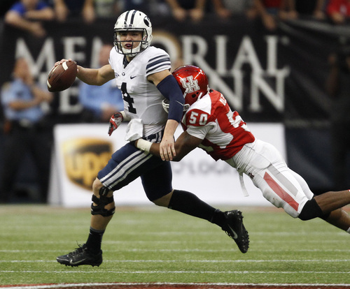 BYU's Taysom Hill (4) is sacked by Houston's Efrem Oliphant during the second half of an NCAA college football game, Saturday, Oct. 19, 2013 in Houston. BYU defeated Houston, 47-46. (AP Photo/Eric Christian Smith)