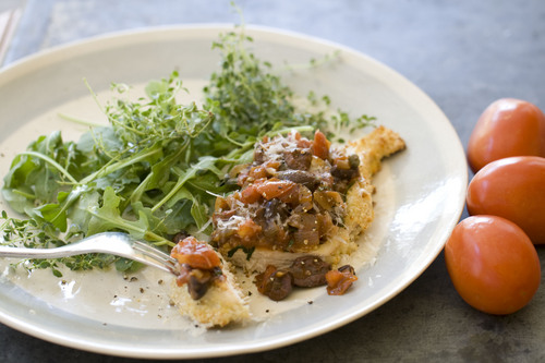 Chicken puttanesca Parmesan is big on flavor, but not on fat and it's easier -- and more weeknight-friendly -- than you might think. (AP Photo/Matthew Mead)