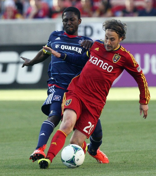 Kim Raff  |  The Salt Lake Tribune (front) Real Salt Lake midfielder Ned Grabavoy (20) tries to hang on to the ball as (back) Chicago Fire forward Patrick Nyarko (14) attacks from behind during the first half of the match at Rio Tinto Stadium in Sandy on May 25, 2013.