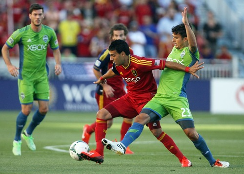 Kim Raff  |  The Salt Lake Tribune (middle) Real Salt Lake midfielder Javier Morales (11) competes with (right) Seattle Sounders FC midfielder Servando Carrasco (23) for a ball during the first half of a game at Rio Tinto Stadium in Sandy on June 22, 2013.