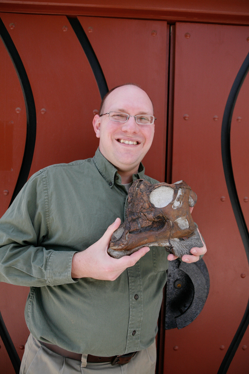 "Raymond M. Alf Museum of Paleontology  |  Courtesy photo Andrew Farke, Augustyn Family Curator at the Raymond M. Alf Museum of Paleontology and lead author on the study, with the skull of the baby Parasaurolophus nicknamed ""Joe."""
