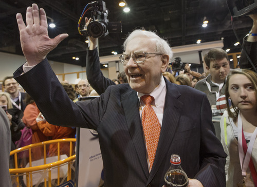 Investor Warren Buffett greets shareholders while touring the exhibit floor prior to holding the Berkshire Hathaway shareholders meeting, in Omaha, Neb., Saturday, May 4, 2013. Tens of thousands attend Berkshire Hathaway shareholders meetings to hear Buffett and Charlie Munger answer questions. No other annual meeting can rival Berkshire's, which is known for its size, the straight talk Buffett and Munger offer and the sales records shareholders set while buying Berkshire products. (AP Photo/Nati Harnik)