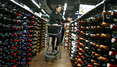Keith Johnson | The Salt Lake Tribune   French wine scholar Sheral Schowe navigates the aisles of the State Wine Store on Harris Avenue in Salt Lake City, Oct. 9, 2013 during her wine education class.  Schowe offers the class for beginners and novices to help them better navigate the wine store, find great deals and interpret wine labels from around the world.